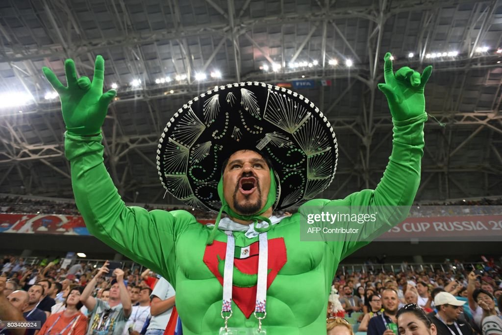 A Mexico supporter cheers for his team before the 2017 FIFA Confederations Cup semi-final football match between Germany and Mexico at the Fisht Stadium in Sochi on June 29, 2017. / AFP PHOTO / Kirill KUDRYAVTSEV