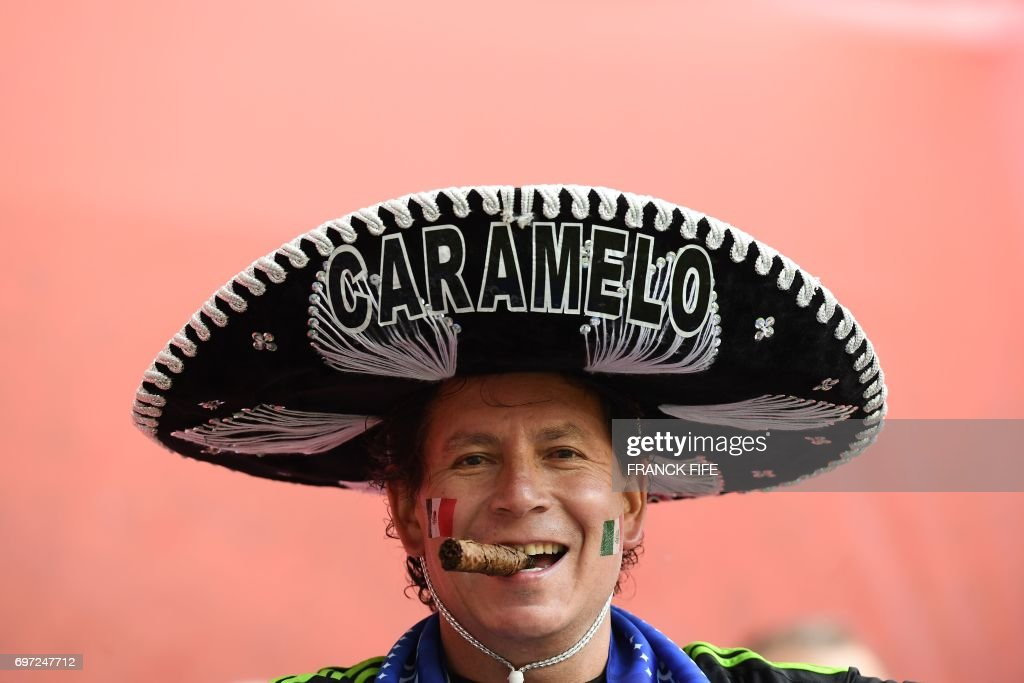 A Mexico supporter poses with a cigar ahead of the 2017 Confederations Cup group A football match between Portugal and Mexico at the Kazan Arena in Kazan on June 18, 2017. /