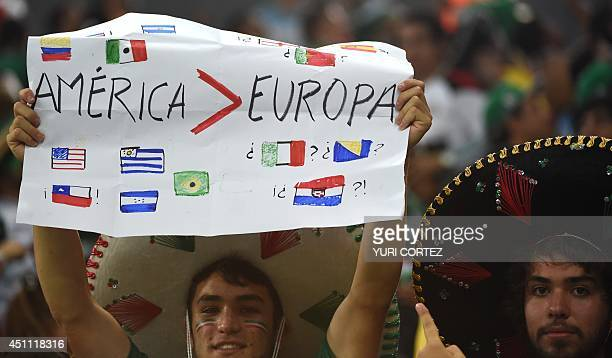 Mexico supporters hold up a poster with different flags of American and European countries at the end of a Group A football match between Croatia and...