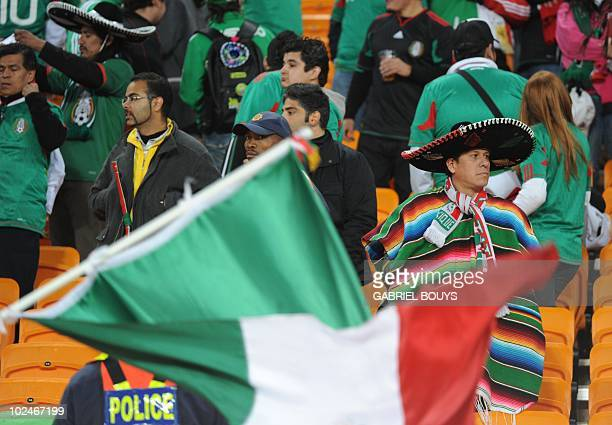 Mexico supporters look dejected after their team lost the 2010 World Cup round of 16 football match Argentina vs Mexico on June 27 2010 at Soccer...