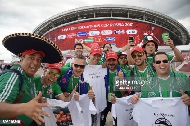 Mexico supporters pose outside the Kazan Arena ahead of the 2017 Confederations Cup group A football match between Portugal and Mexico in Kazan on...