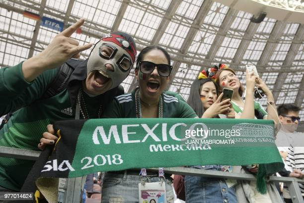 Mexico supporters pose prior to the Russia 2018 World Cup Group F football match between Germany and Mexico at the Luzhniki Stadium in Moscow on June...