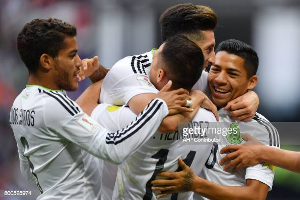 Mexico teammates celebrate after forward Hirving Lozano scored the team's second goal during the 2017 Confederations Cup group A football match...