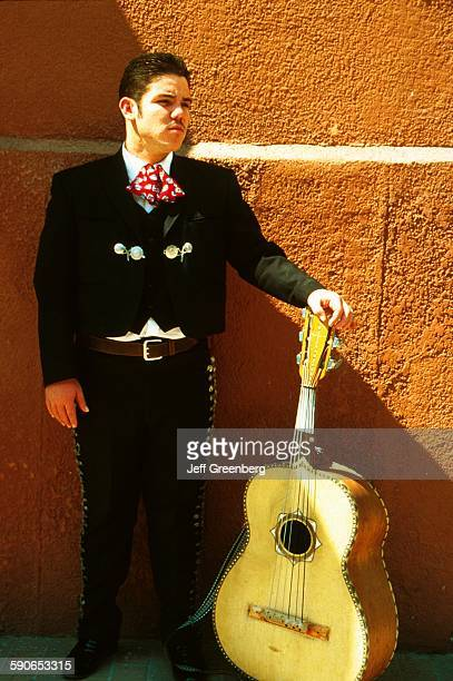 Mexico Tlaquepaque Mariachi Band Member Standing With Guitar On Calle Independencia Independence Street