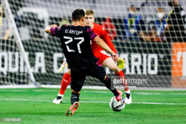Mexico Uriel Antuna dribbles the ball towards Iceland goalkeeper Runar Alex Runarsson during the game between Mexico and Iceland on May 29, 2021 at...