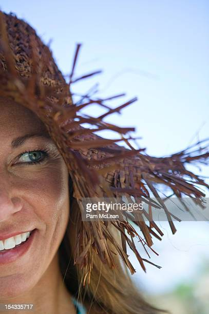 Mexico, Woman wearing straw hat and smiling