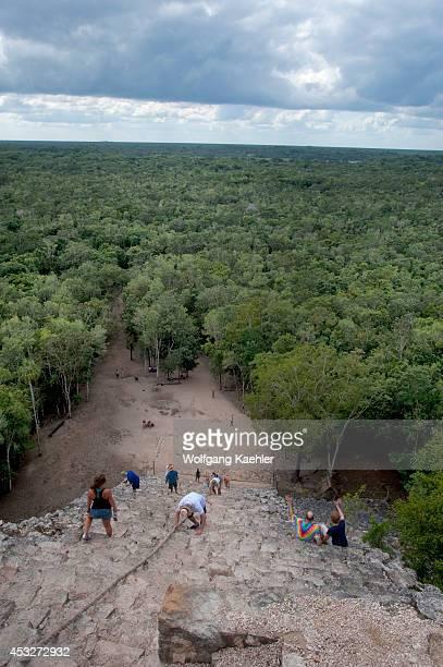 Mexico Yucatan Peninsula Near Cancun Maya Ruins Of Coba Nohoch Mut Group Tourists Climbing Castle Pyramid