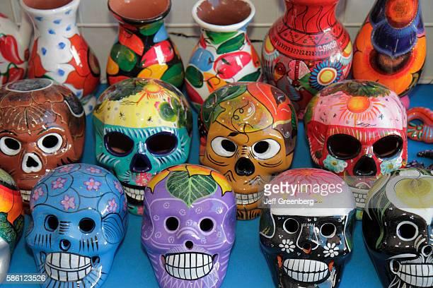 Mexico Yucat‡n Peninsula Quintana Roo Cancun Mercado 28 souvenirs shopping vendor stall selling clay masks vases and skeletons