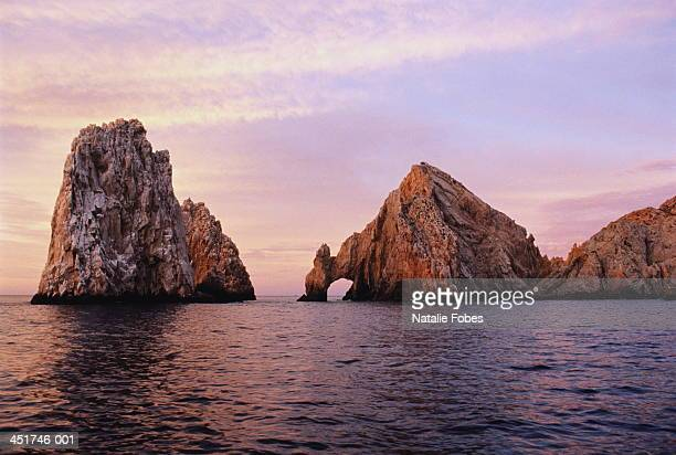 mexico,cabo san lucas, the arch rock formation in sea at dawn - cabo san lucas stock pictures, royalty-free photos & images