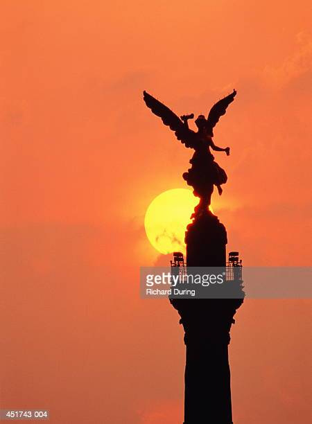 Mexico,Mexico City, sun setting behind Monument of Independence