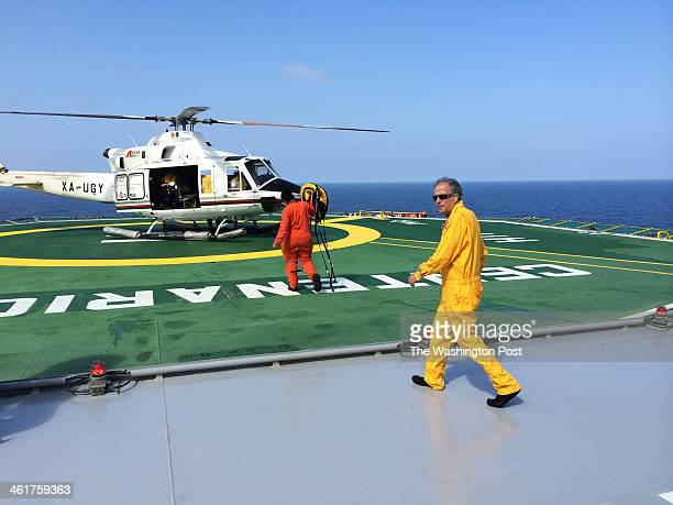 Pemex officials at the helipad on the company's Centenario oil platform in the deep waters of the Gulf of Mexico