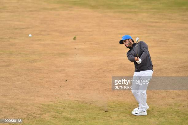 Mexico's Abraham Ancer plays his approach shot on the 6th hole during a practice round at The 147th Open golf Championship at Carnoustie Scotland on...