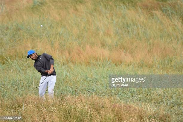 Mexico's Abraham Ancer plays out of the rough on the 6th hole during a practice round at The 147th Open golf Championship at Carnoustie Scotland on...