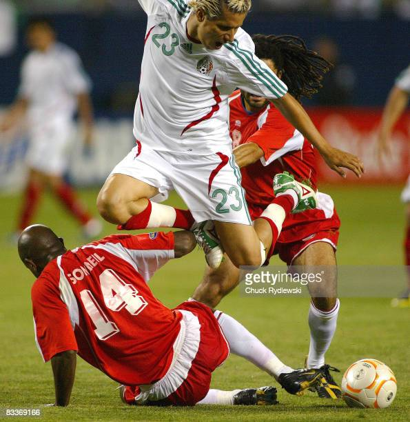 Mexico's Adolfo Bautista tries to split the Guadeloupe defense during their semifinal match Mexico vs Guadeloupe at the CONCACAF 2007 Gold Cup at...