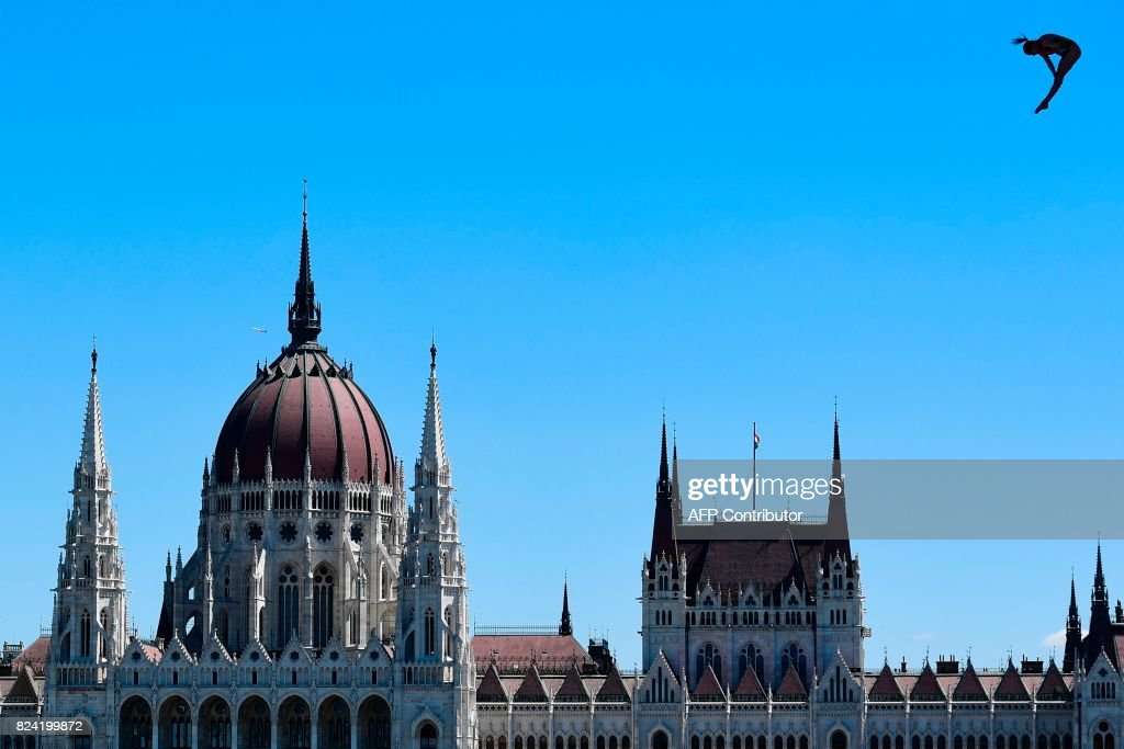 Mexico's Adriana Jimenez silhouettes against the sky near the Hungarian Parliament Building as she competes in the women's 20 meters high diving event at the 2017 FINA World Championships on July 29, 2017 in Budapest. / AFP PHOTO / Martin BUREAU