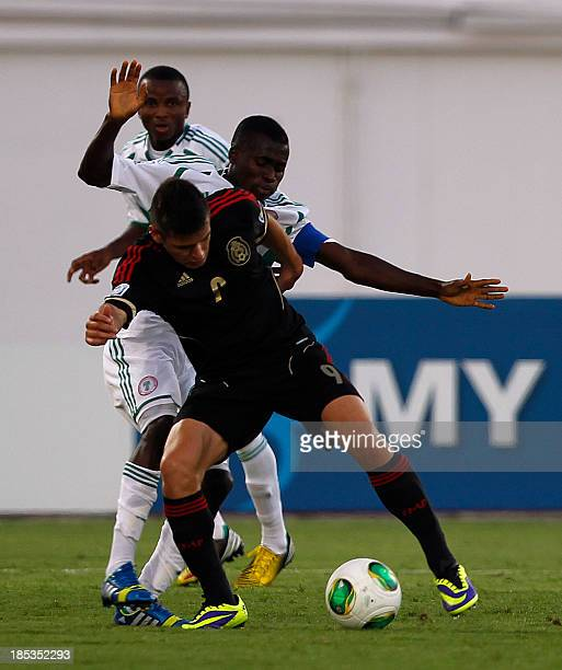 Mexico's Alejandro Diaz vies with Nigeria's Chidiebere Nwakali during the FIFA U17 World Cup UAE 2013 mexico versus Nigeria at the Khalifa binZayed...