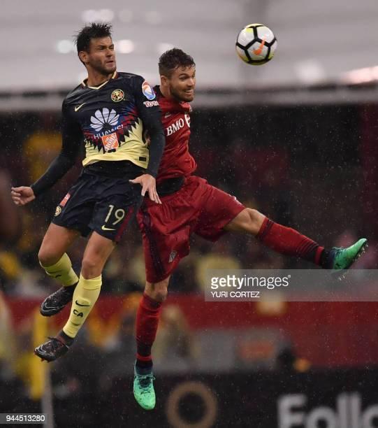 Mexico's America Alejandro Diaz vies for the ball with Canada's Toronto FC Eriq Zavaleta during their semifinal secong leg football match of CONCACAF...