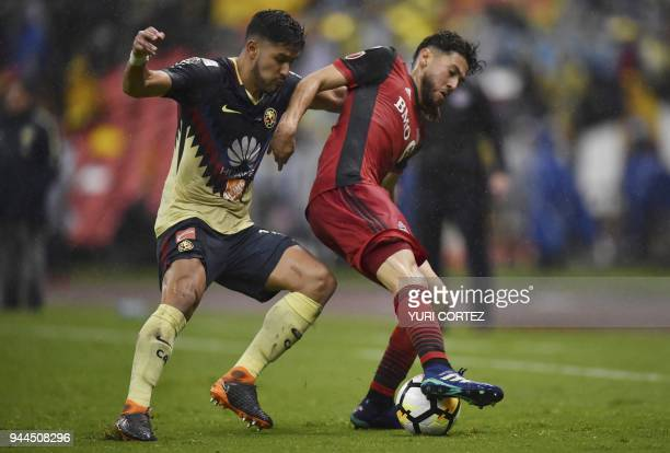 Mexico's America defender Bruno Valdez vies for the ball with Canada's Toronto FC Jonathan Osorio during their semifinal secong leg football match of...