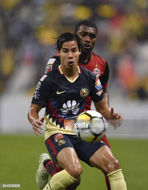 Mexico's America Diego Lainez vies for the ball with Canada's Toronto FC Ashtone Morgan during their semifinal secong leg football match of CONCACAF...