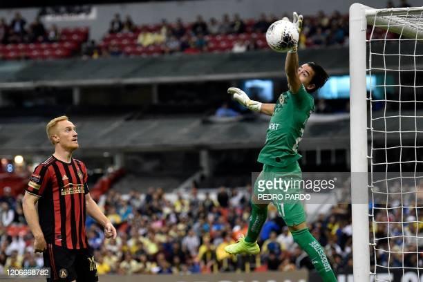 Mexico's America goalkeaper Oscar Jimenez stops the ball as US Atlanta United Jeffrey Larentowicz looks at during their CONCACAF Champions League...