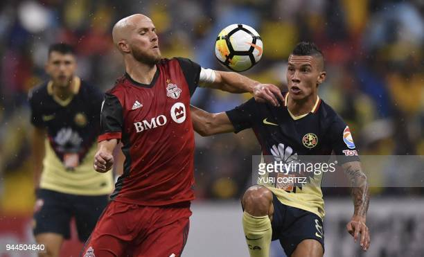 Mexico's America Mateus Uribe vies for the ball with Canada's Toronto FC Michael Bradley during their semifinal secong leg football match of CONCACAF...
