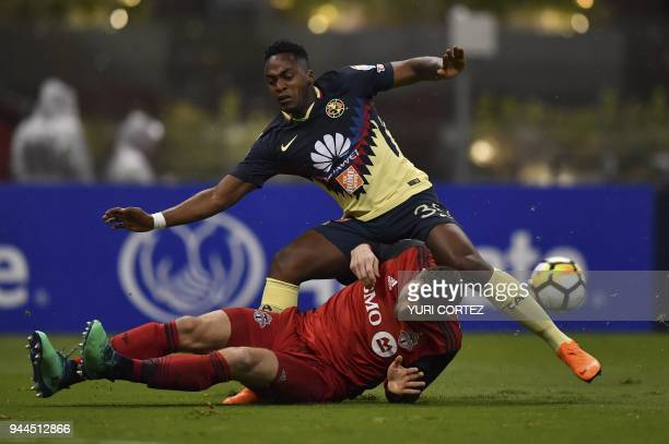 Mexico's America Renato Ibarra vies for the ball with Canada's Toronto FC Eriq Zavaleta during their semifinal secong leg football match of CONCACAF...
