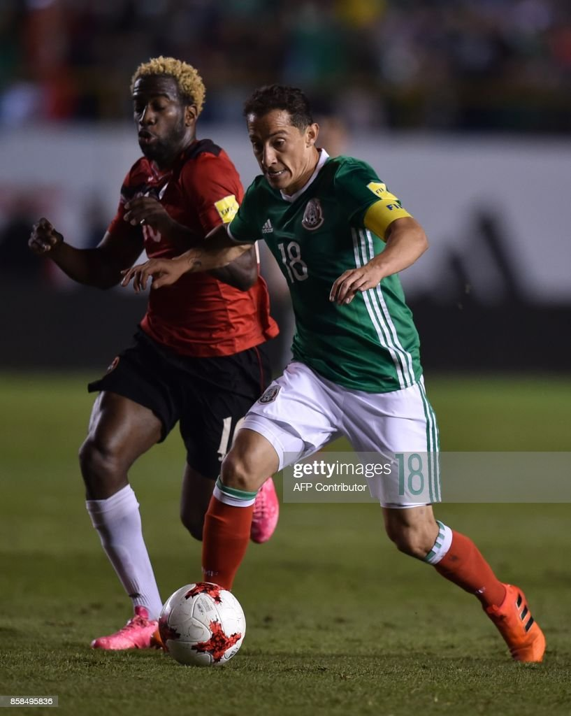 Mexico's Andres Guardado Trinidad and Tobago's Kevin Molino vie for the ball during their 2018 World Cup qualifier football match in San Luis Potosi, Mexico, on October 6, 2017. /