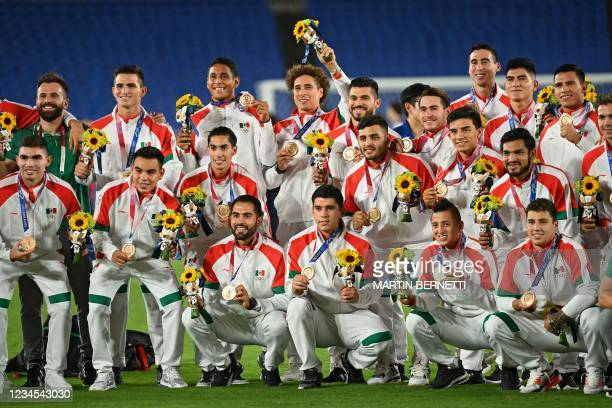 Mexico's bronze medallists pose for the press during the medal ceremony of the Tokyo 2020 Olympic Games men's football competition at Yokohama...