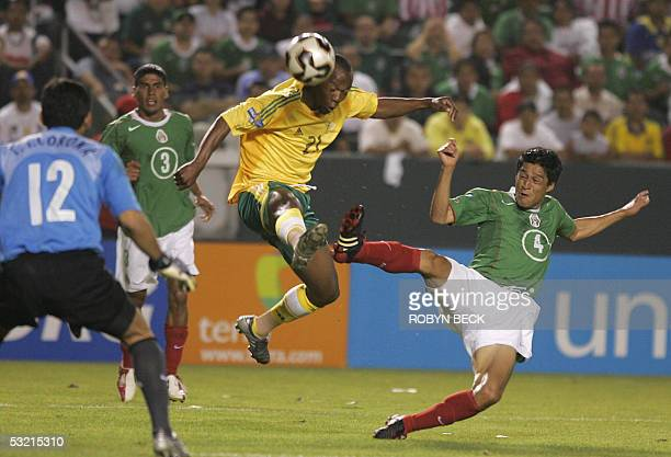 South african gift leremi stock photos and pictures getty images mexicos carlos arnbaldo salcido and south africas gift leremi battles at the south africa goal defended negle Images