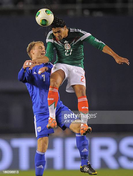 Mexico's Carlos Pena and Finland's Tim Vayrynen vie for the ball during a friendly match between Mexico and Finland at Qualcomm stadium on October 30...