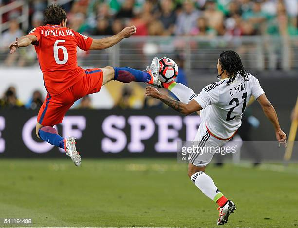 Mexico's Carlos Pena vies for the ball with Chile's Jose Fuenzalida during a Copa America Centenario quarterfinal football match in Santa Clara...