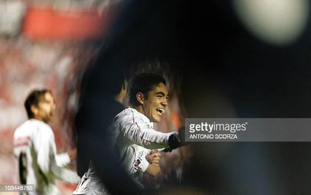 Mexico's Chivas footballer Marcos de la Mora celebrates after scoring against Brazil's Internacional in their Libertadores Cup final on August 18 at...