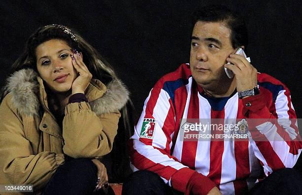 Mexico's Chivas supporters react in dejection after Brazilian Internacional defeated their team during the Libertadores final football match at Beira...