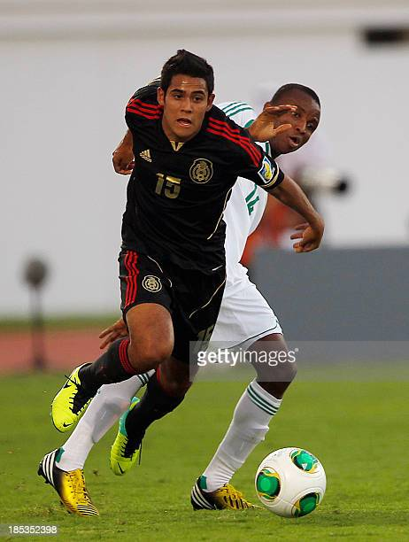 Mexico's Christian Tovar is chllenged by Nigeria's Chidiebere Nwakali during the FIFA U17 World Cup UAE 2013 mexico versus Nigeria at the Khalifa...