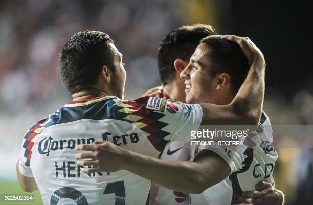 Mexicos Club America player Cecilio Dominguez celebrates with teammate Henry Martin after scoring against Costa Rica's Deportivo Saprissa during a...