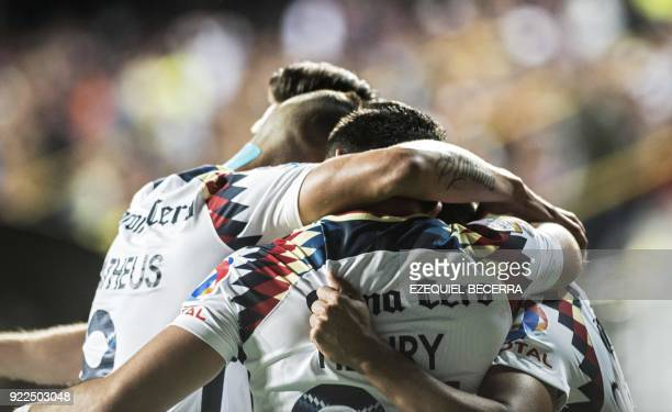 Mexicos Club America player Cecilio Dominguez celebrates with teammates Henry Martin and Mateus Uribe after scoring against Costa Rica's Deportivo...