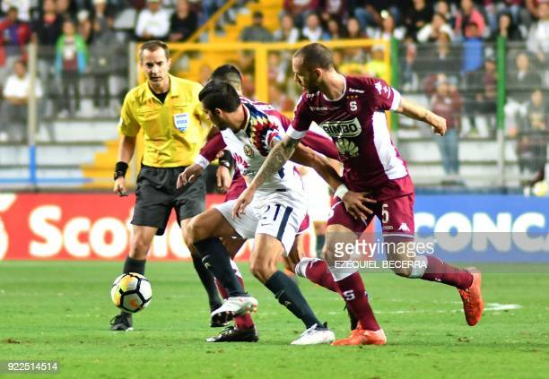 Mexicos Club America player Henry Martin vies for the ball with Costa Rica's Deportivo Saprissa player Henrique Moura in their Concacaf Champions...