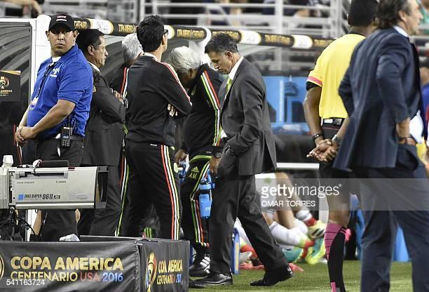Mexico's coach Juan Carlos Osorio reacts in dejection during the Copa America Centenario quarterfinal football match against Chile in Santa Clara...