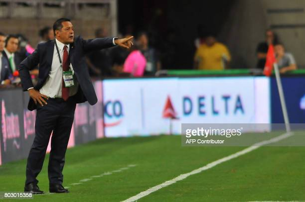 Mexico's coach Luis Pompillo gives instructions during the friendly match between Mexico and Ghana at NRG stadium on June 28 2017 in Houston Texas /...