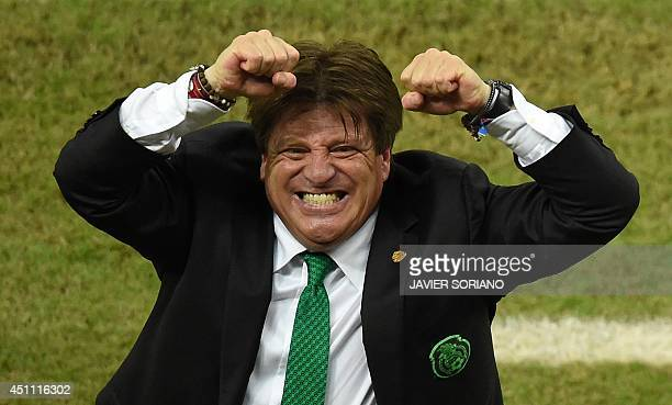 Mexico's coach Miguel Herrera celebrates after a Group A football match between Croatia and Mexico at the Pernambuco Arena in Recife during the 2014...