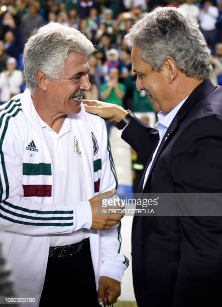 Mexico's coach Ricardo Ferretti greets Chile's coach Reinaldo Rueda before the start of a friendly football match between Mexico and Chile at the La...