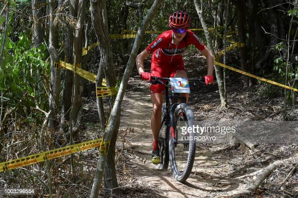 Mexico's Daniela Campuzano competes in the Women's Mountain Bike Cross Country finals event of the cyclying competition of the 2018 Central American...