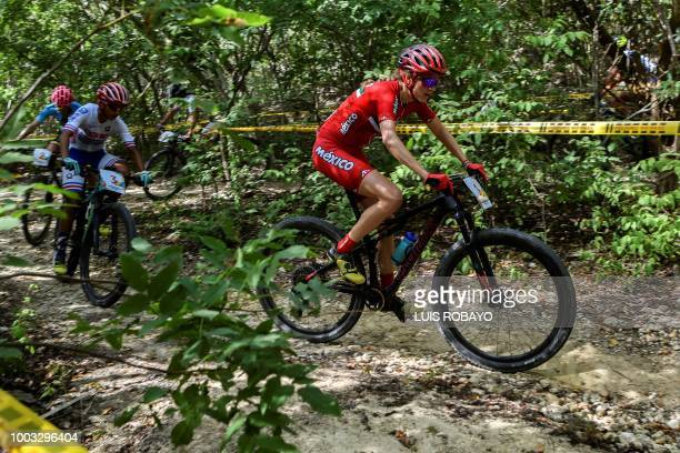 Mexico's Daniela Campuzano Costa Rica's Milagro Mena and Colombia's Laura Abril compete in the Women's Mountain Bike Cross Country finals event of...