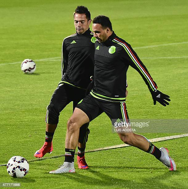 Mexico's defender Adrian Aldrete and forward Enrique Esqueda attend a training session at the National Stadium in Santiago on June 14 during the...