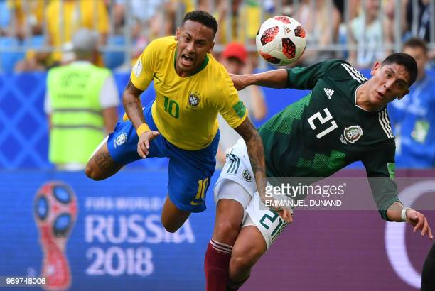 Mexico's defender Edson Alvarez fouls Brazil's forward Neymar during the Russia 2018 World Cup round of 16 football match between Brazil and Mexico...