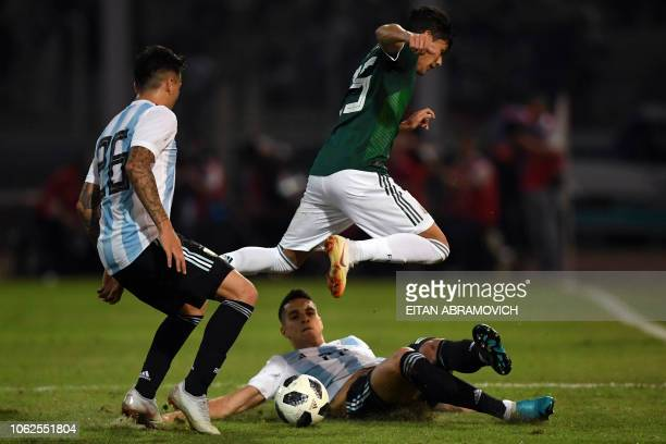 Mexico's defender Gerardo Arteaga vies for the ball with Argentina's midfielder Erik Lamela during their friendly football match at Mario Alberto...