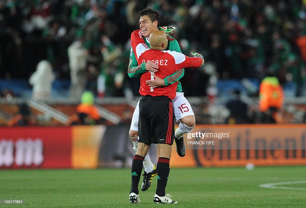 6eb0d2918 Mexico s defender Hector Moreno and Mexico s goalkeeper Oscar Perez ...