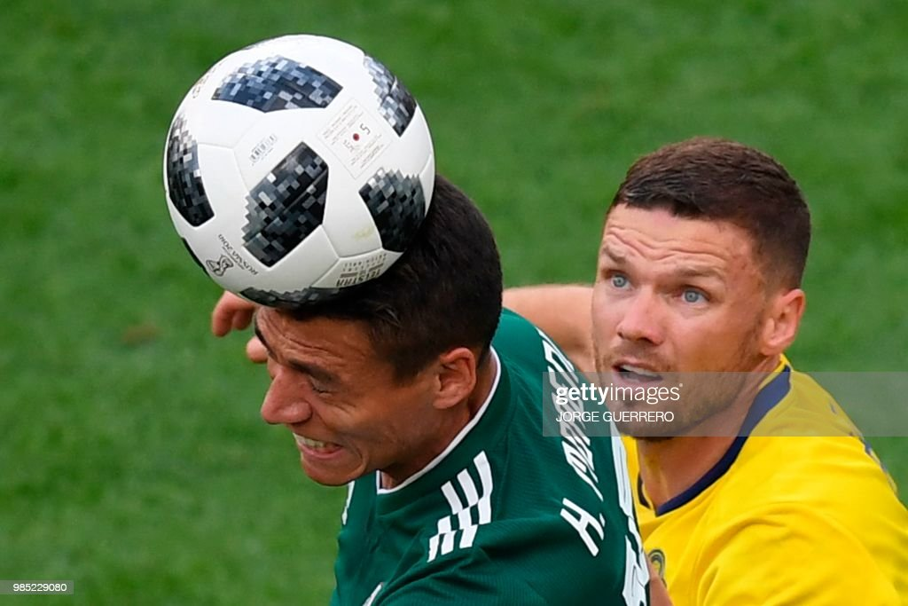 TOPSHOT - Mexico's defender Hector Moreno and Sweden's forward Marcus Berg vie for the ball during the Russia 2018 World Cup Group F football match between Mexico and Sweden at the Ekaterinburg Arena in Ekaterinburg on June 27, 2018. (Photo by JORGE GUERRERO / AFP) / RESTRICTED
