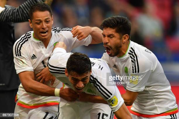 TOPSHOT Mexico's defender Hector Moreno celebrates with Mexico's forward Javier Hernandez and Mexico's forward Oribe Peralta after scoring during the...