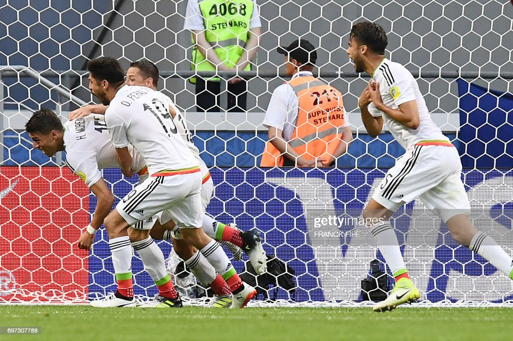 77bddbc30 Mexico s defender Hector Moreno celebrates with team mates after ...
